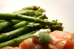 Asparagus and smoked salmon. Fresh green asparagus served with smoked salmon royalty free stock images