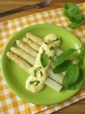 Asparagus with sorrel hollandaise sauce Stock Photos