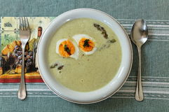 Asparagus soup. With eggs on the table stock photo