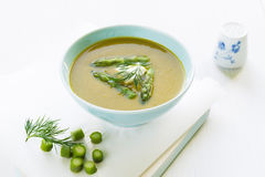 Asparagus soup in a bowl with fresh cream, dill and chive Stock Photo