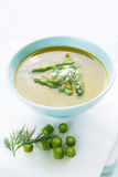 Asparagus soup in a bowl topped with fresh cream, dill and chive Stock Photography