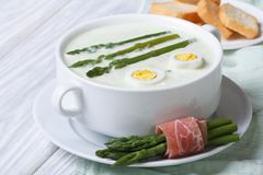Asparagus soup with eggs in white bowl Stock Photo