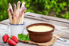 Asparagus soup, fresh asparagus, strawberries Royalty Free Stock Photography