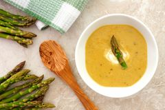Asparagus soup overhead setting on white granite background Stock Image