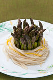 Asparagus with spaghetti pasta Stock Image