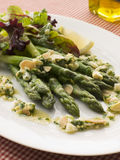 Asparagus Spears with Polonaise Vinaigrette. And Salad Leaves royalty free stock photography