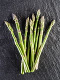 Asparagus sprouts on the black background. royalty free stock photography