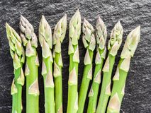 Asparagus sprouts on the black background. royalty free stock photos