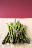 Asparagus stalks on a woven mat Stock Photo
