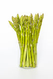 Asparagus Standing In A Glass On A White Backgrou Royalty Free Stock Photo