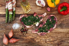 Asparagus and steak for grilling Royalty Free Stock Images