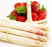Asparagus and strawberries. Asparagus und strawberries in the basket Royalty Free Stock Photography