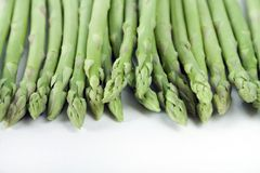 Asparagus tips. A closeup of young asparagus spears and tips, isolated on a white background Royalty Free Stock Images