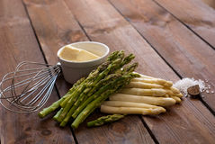 Asparagus tips with salt and butter Stock Photos