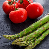 Asparagus, tomatoes Stock Images