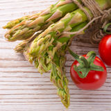 Asparagus tomatoes oil Royalty Free Stock Photo
