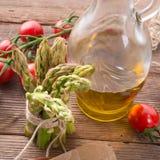 Asparagus tomatoes oil Stock Photo