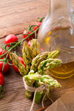 Asparagus tomatoes oil Royalty Free Stock Image