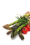 Asparagus With Tomatos. Asparagus spears with thyme and cherry tomatos Royalty Free Stock Image