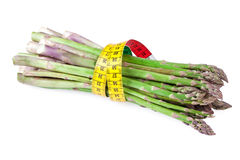 Asparagus vegetable with measuring tape Royalty Free Stock Image