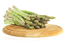 Asparagus vegetable on wooden chopping board Royalty Free Stock Images