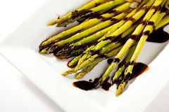 Asparagus with Vegetables. Fried Asparagus with Sliced Vegetables and Sauce Stock Images