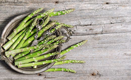 Asparagus vegetables rustic wooden background Royalty Free Stock Images
