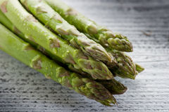 Asparagus on wood Stock Images