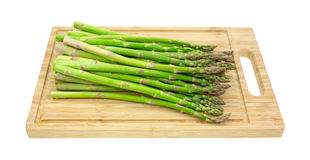 Asparagus on wood cutting board Stock Images