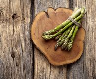 Asparagus on wooden background stock image