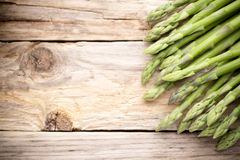 Asparagus on the wooden background. Royalty Free Stock Photos