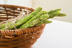 Asparagus in a wooden basket Royalty Free Stock Photo