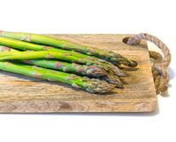 Asparagus on wooden board Stock Images