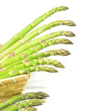 Asparagus. On a wooden crate on white background Stock Photography
