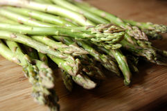 Asparagus on wooden cutting board Stock Photo