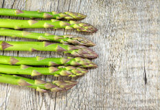 Asparagus on wooden table Royalty Free Stock Images