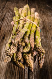Asparagus on a wooden table Royalty Free Stock Photography