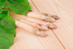 Asparagus on a wooden table in the closeup. Stock Image