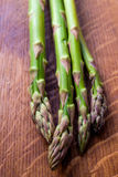 Asparagus on wooden table Royalty Free Stock Image