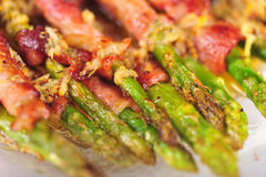 Asparagus wrapped in bacon Stock Photo