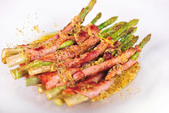 Asparagus wrapped in bacon Stock Images
