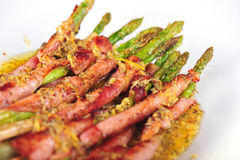 Asparagus wrapped in bacon Stock Photos
