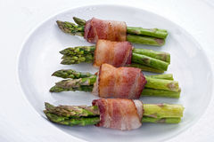 Asparagus Wrapped in Bacon. Royalty Free Stock Photos