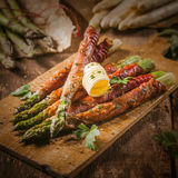 Asparagus Wrapped in Bacon with Curl of Butter Stock Image