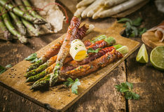 Asparagus Wrapped in Bacon with Curl of Butter Stock Photography
