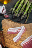 Asparagus wrapped in italian pancetta ham Stock Photos