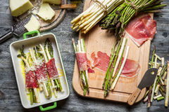 Asparagus wrapped in Parma ham casserole Stock Images