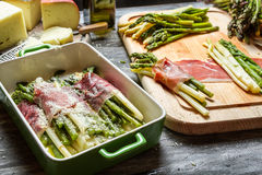Asparagus wrapped in Parma ham with cheese Stock Photo