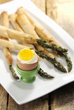 Food: Asparagus wrapped in thin puff pastry with soft boiled egg Royalty Free Stock Images