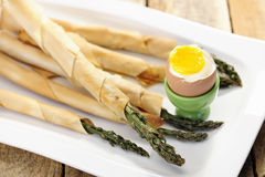 Food: Asparagus wrapped in thin puff pastry with soft boiled egg Stock Photos